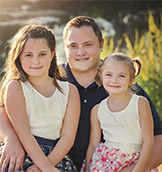Derek Messner, senior designer of IDU Creative design studio (and his daughters)